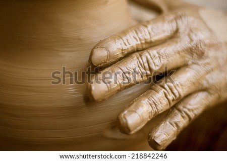 Potter hand  - stock photo