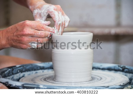 Potter make raw bowl by hands - stock photo
