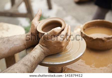 Potter making vessel, detail work with clay, handicraft Spanish - stock photo