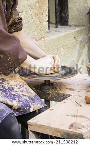 Potter working with clay craft, business
