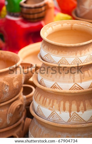 Pottery for sale at a souvenir shop in Romania. - stock photo