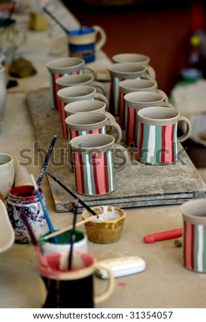 Pottery mugs - stock photo