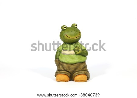 Pottery- statuette of  fabulous frog on white background.