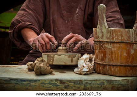 pottery works on the old ring - stock photo