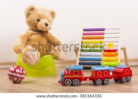 potty training teddy - stock photo