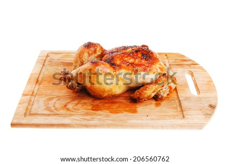 poultry : homemade roast whole turkey on wooden cutting board isolated over white background - stock photo