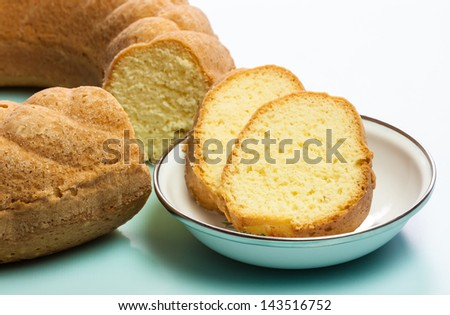 Pound Cake Slices - A macro view of the slices of a delicious golden brown crusted pound bundt cake baked in a ring shaped pan with fluted sides. The image has a shallow Depth-of-Field. - stock photo