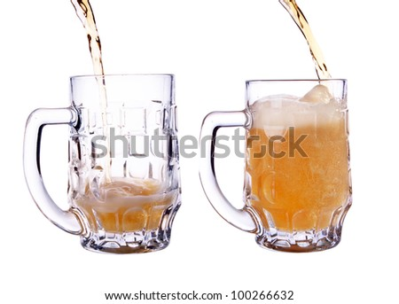 pour a glass of beer. shot on a white background - stock photo