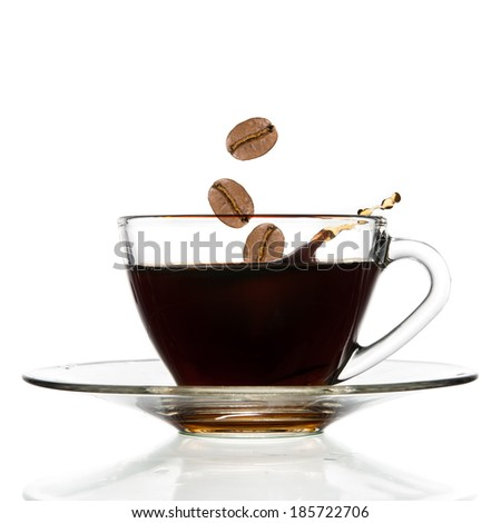 Pour coffee and beans into glass cup, isolated on white background. - stock photo