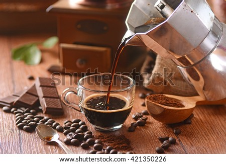 pour coffee into glass cup - stock photo