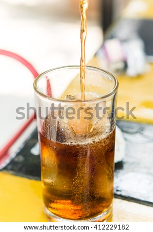 Pour cold cola put glass,fizz,thristy - stock photo