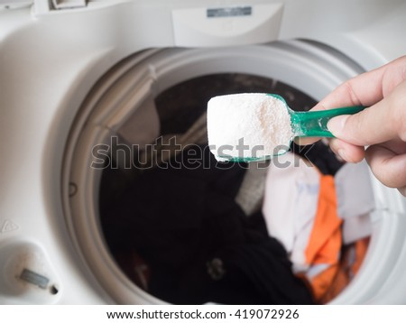 Pour detergent into washing machine
