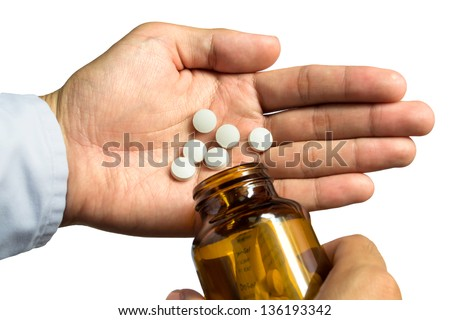 Pour medication at hand - stock photo