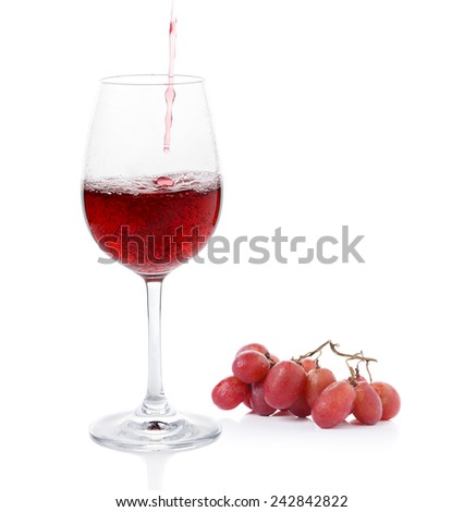 Poured red wine ,grapes of wrath on white background - stock photo