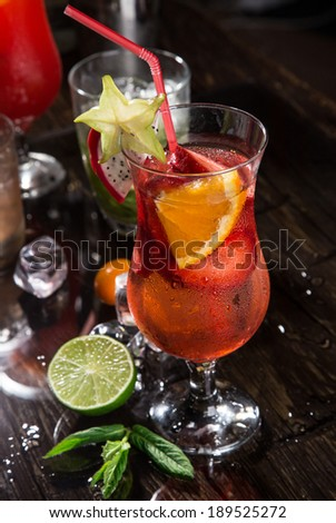 Pouring a cocktail into glass, close-up. - stock photo