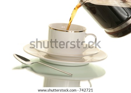 pouring a cup of hot coffee from a coffee craft on white - stock photo
