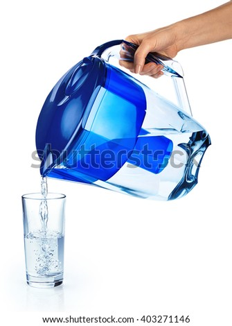 Pouring a glass of purified water isolated on white background. Water filter. - stock photo