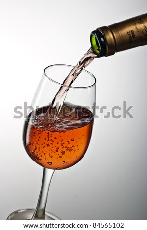 Pouring a glass of rosé wine