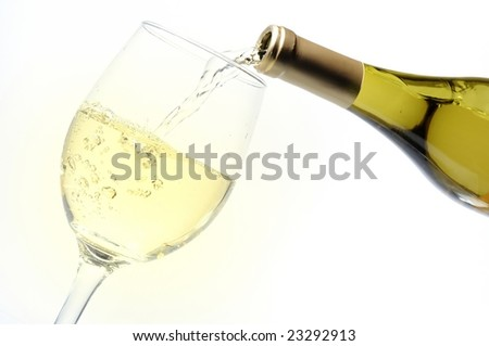 pouring alcohol into a glass - stock photo
