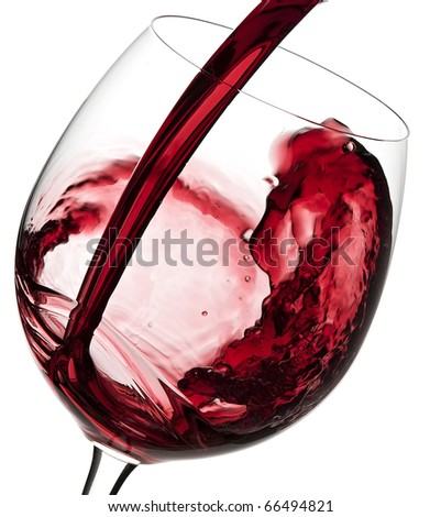 Pouring Australian red wine into the wine glass  isolated on white background - stock photo