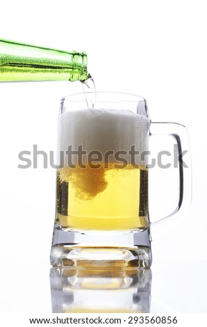 pouring beer glass to drink beer on white background - stock photo