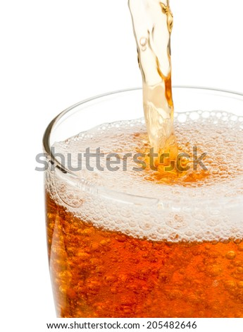 Pouring beer in glass isolated on white background - stock photo