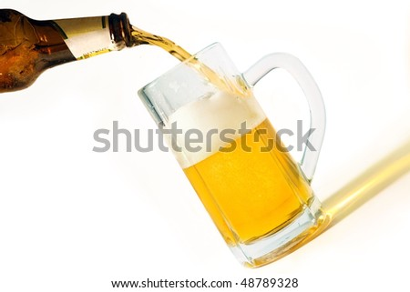 Pouring beer into a mug, isolated on white background