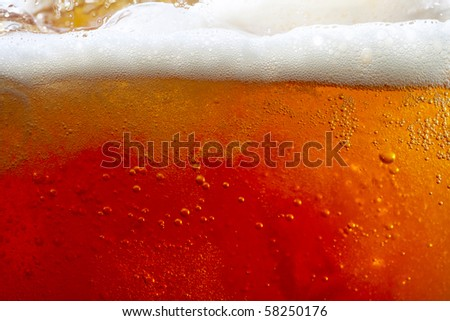 pouring beer with bubbles and froth. super large background - stock photo