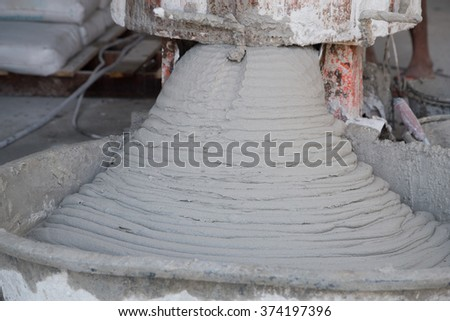 pouring cement or mortar from cement mixer to salver for applying construction