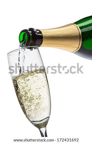 pouring champagne into glass - stock photo