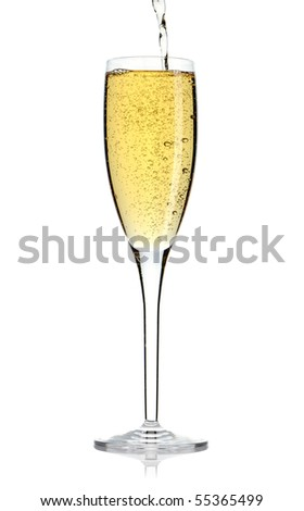 Pouring champagne wine into a glass - stock photo