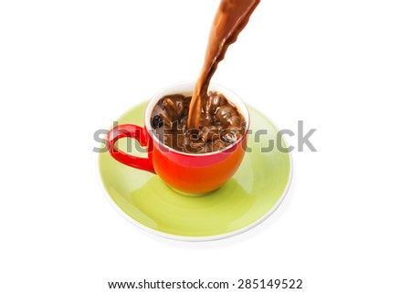 Pouring coffee into the  red cup - stock photo
