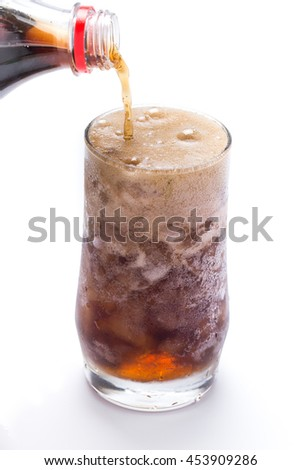 pouring cola glass bubble splash on white background