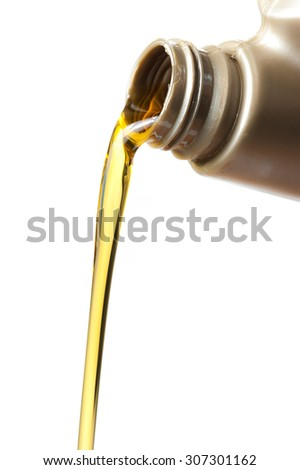 pouring engine oil from its plastic container on white background,Selective focus