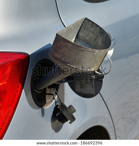 pouring fuel into the car gas tank - stock photo