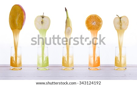 pouring juice into a glass - stock photo