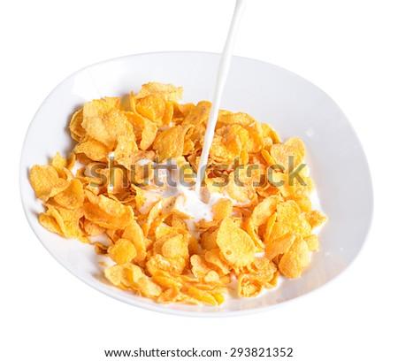 pouring milk into bowl of corn flakes - stock photo