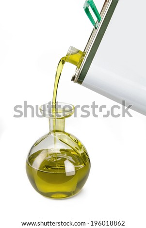Pouring oil / studio photography of olive oil over white background  - stock photo