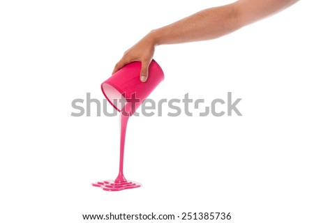 pouring paint from colored container on white background - stock photo