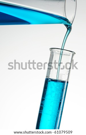 Pouring reagent into test tube - stock photo