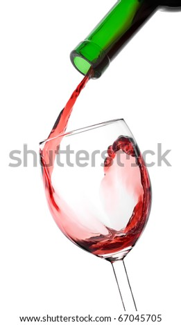 Pouring red wine in the glass from bottle