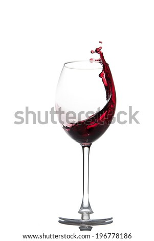 Pouring red wine isolated on white - stock photo