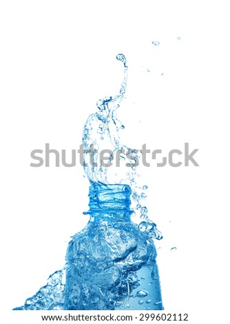 Pouring splash water from bottle on white background - stock photo