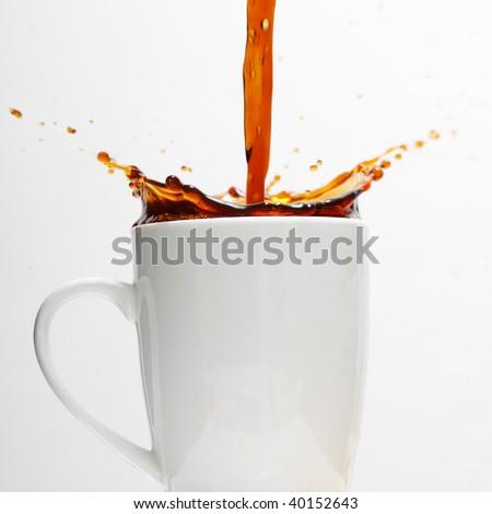 Pouring splashing coffee - stock photo