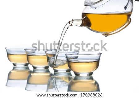 Pouring Tea into Glass Cup  - stock photo