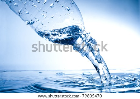 pouring water from water bottle - stock photo