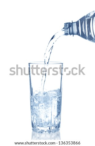 pouring water in a glass on white background - stock photo