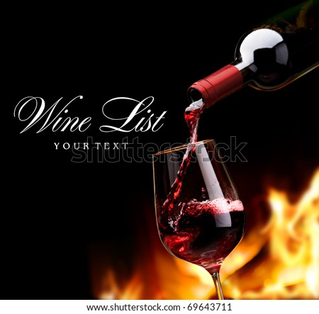 pouring wine by the fireplace - stock photo
