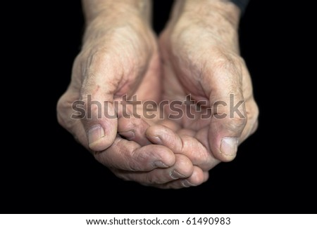 Poverty. Old hands on black with clipping path - stock photo