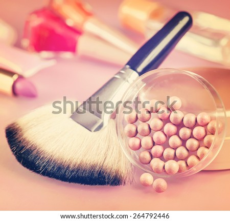 Powder and brush for makeup on the table. Vintage retro hipster style version